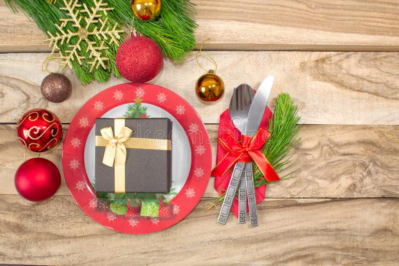Set for Christmas tables, tangerines, decorations, fir and a plate with a gift and cutlery. Festive background. Holiday background royalty free stock photos
