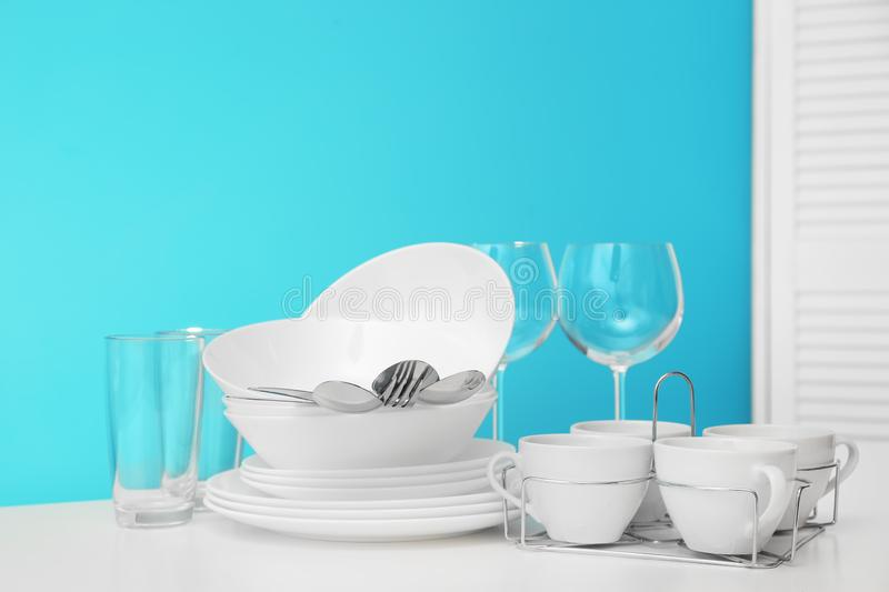 Set of clean dishware on table stock photo