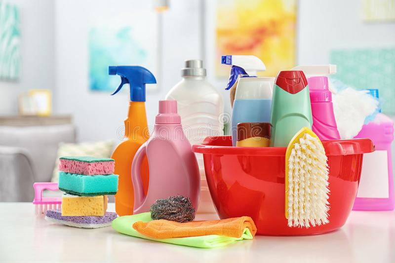 Set of cleaning supplies on table. Indoors royalty free stock photos