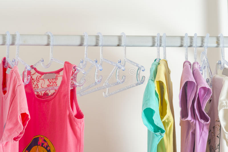 Set of clothes for kids on hangers. Shopping. royalty free stock photos