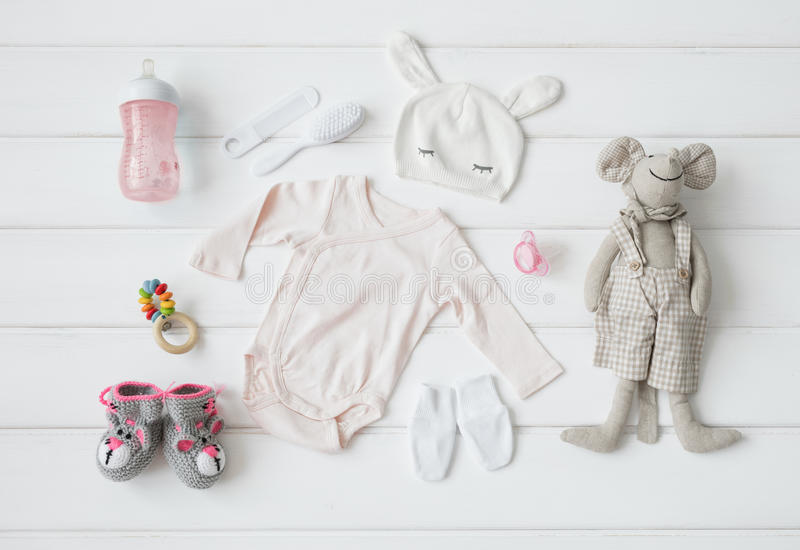 Set of clothing and items for a baby stock images