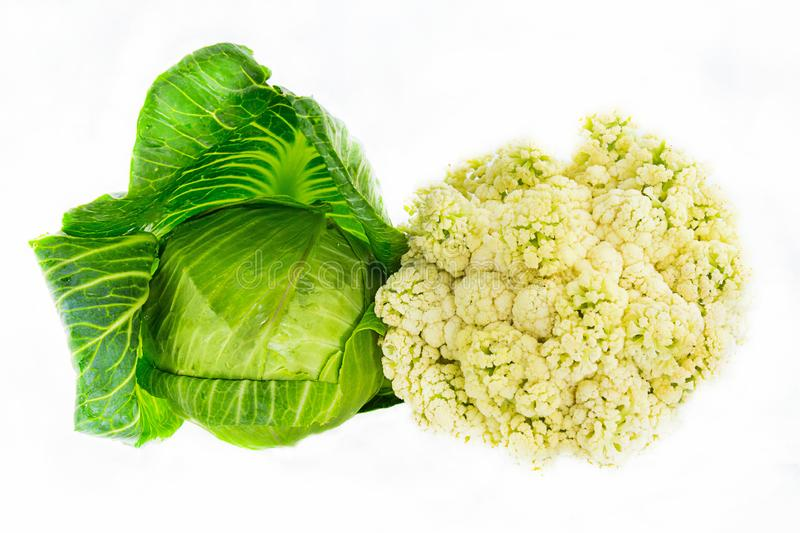 Set collection of cabbage whole fruit young white and colored contrasting couple on a white background close-up stock photos