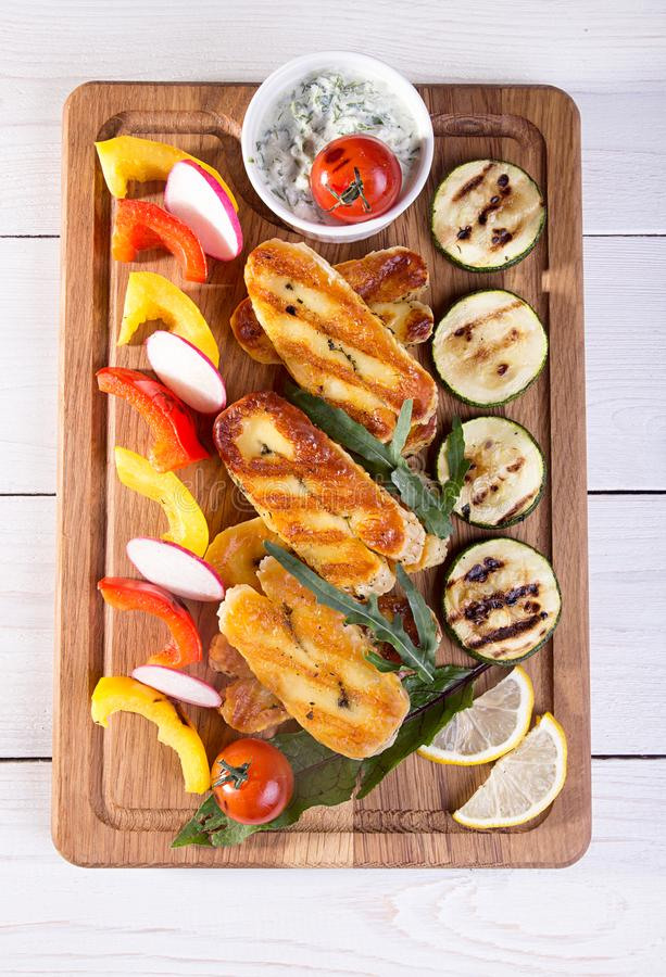 Set collection of cheese and snacks. Grilled halloumi, pepper, z stock image