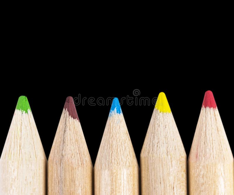 Set of color pencils isolated on black background. Multicolored pencils isolated. Set of color pencils isolated on black background. Multicolored pencils stock photos