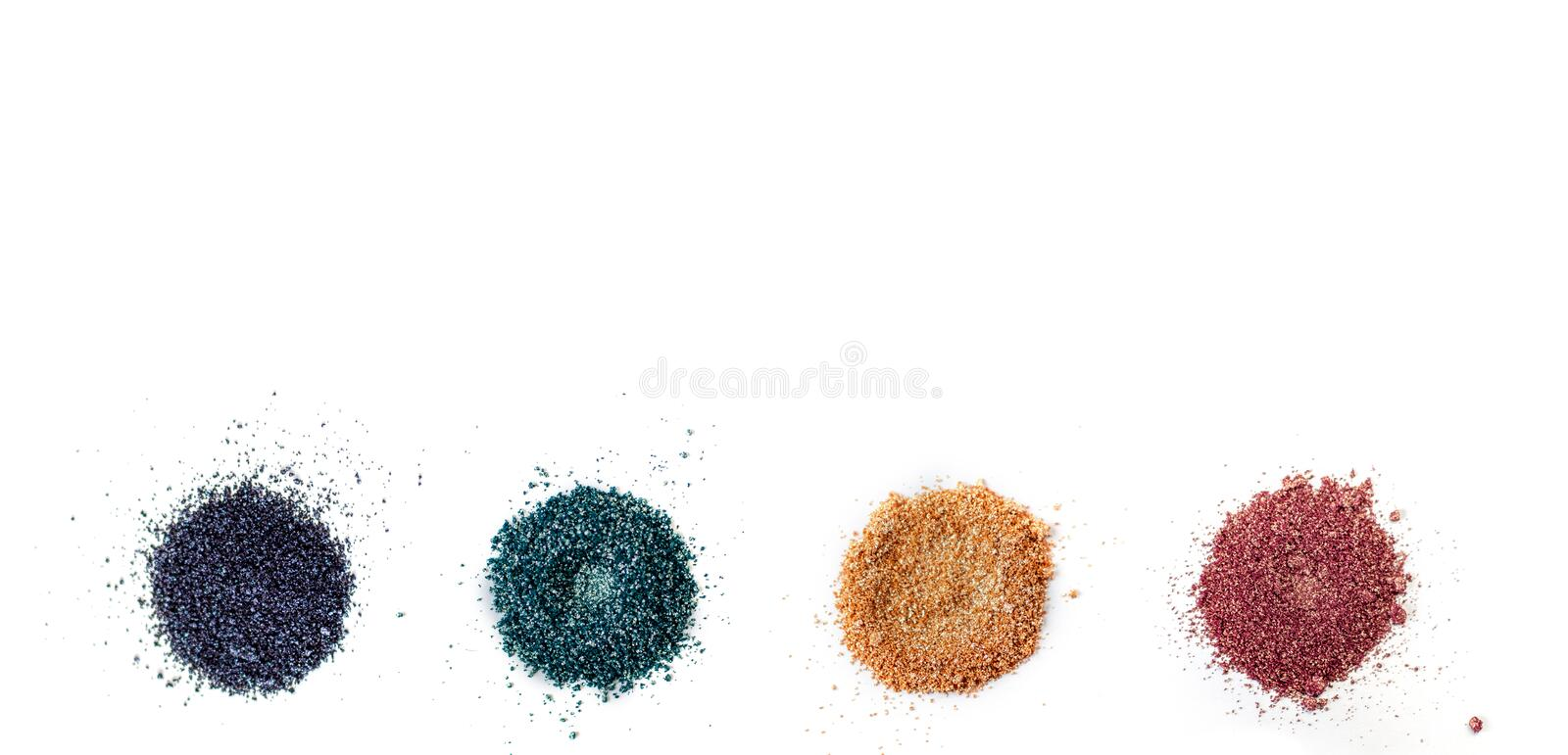A set of color pigments in different shades, pigment powder close up, glitter eyeshadow or mica. Isolated on a white. Background, top view stock photo
