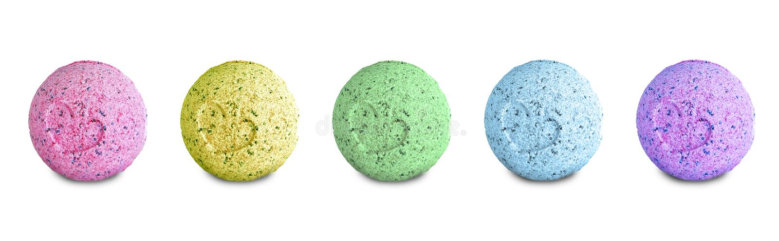 Set of colored bath bombs isolated on white background. stock photo