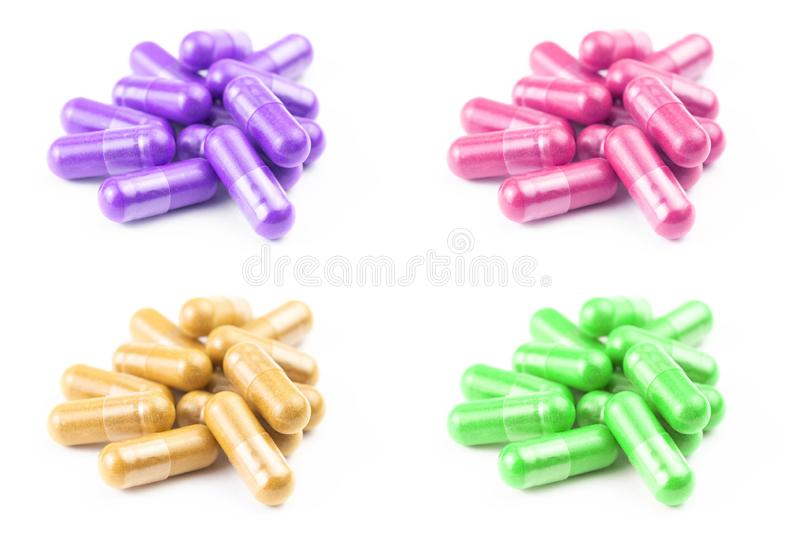 Set of of colored organic capsules isolated on white background closeup with selective focus stock images