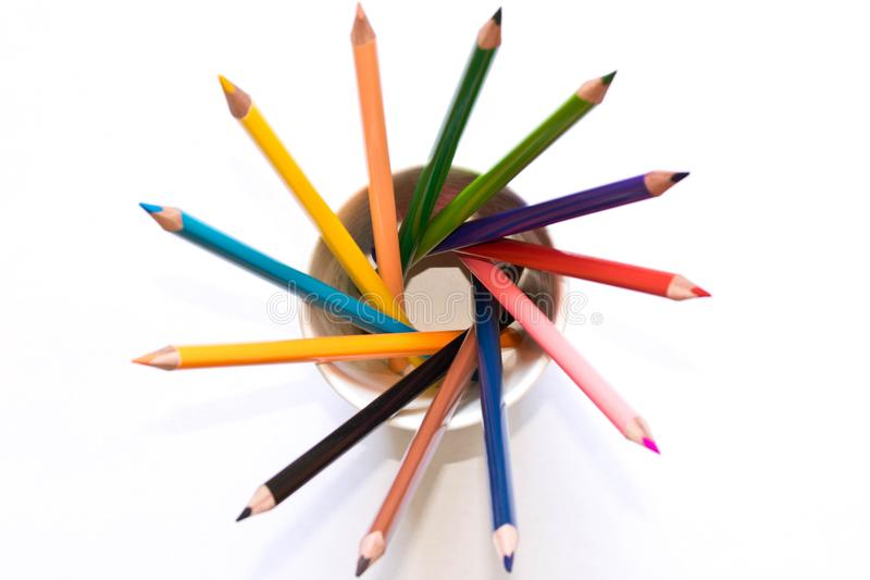 Set of colored pencils in a glass on a white background . The vi royalty free stock photos