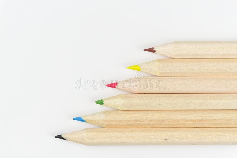 Set of colored pencils on a white background. Arranged in a row stock photography