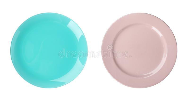 Set of colorful ceramic plates for kids on white, top view royalty free stock image