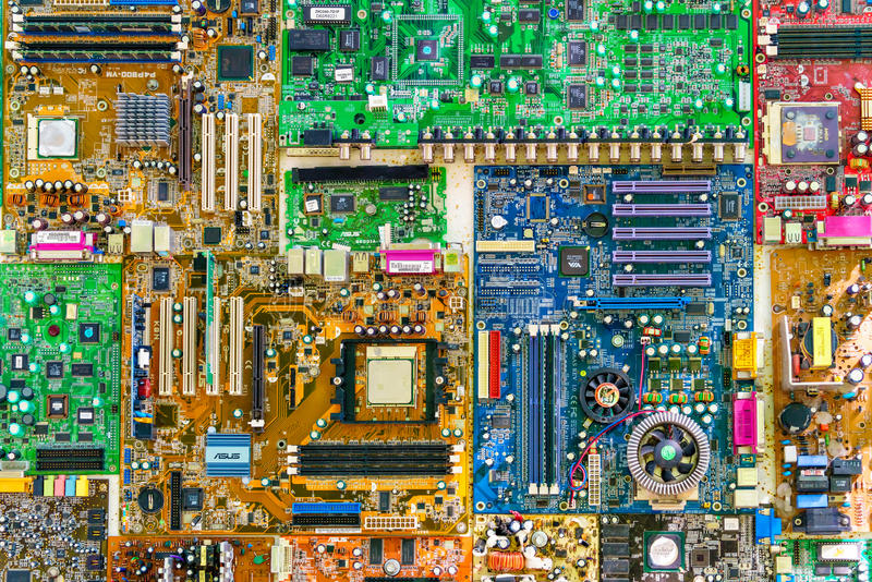 Set of colorful computer motherboards of different manufacturers. Disassembled PC components under repair. Used boards technologic stock photography