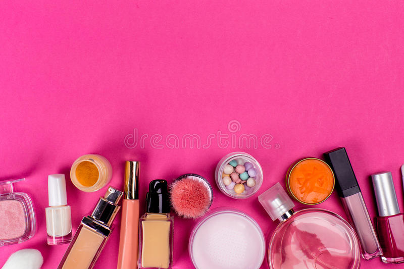 Set of colorful cosmetics. On pink table stock images