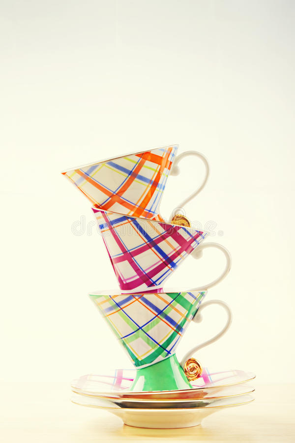 Set of colorful cups pyramid on white background stock photos