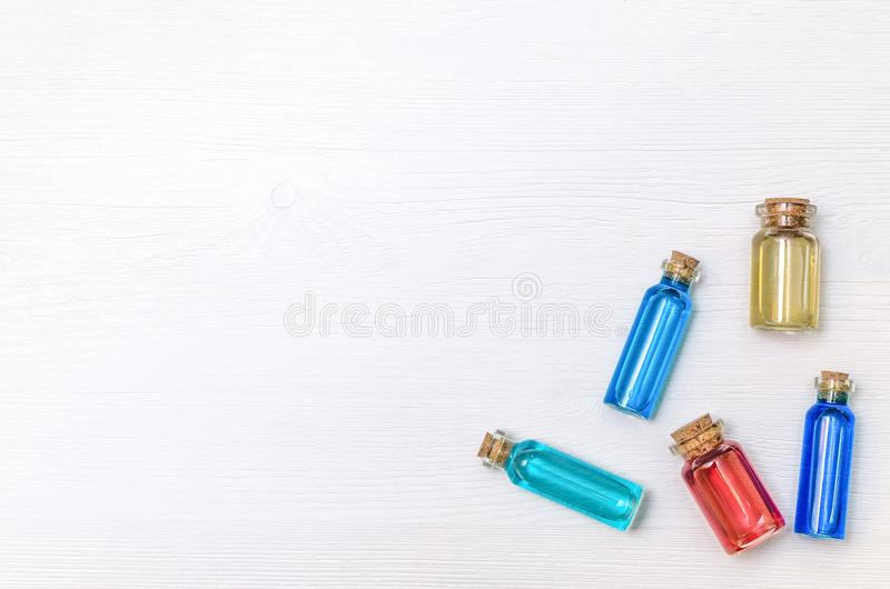 Set of colorful essence oil tincture on white wooden background. royalty free stock photography