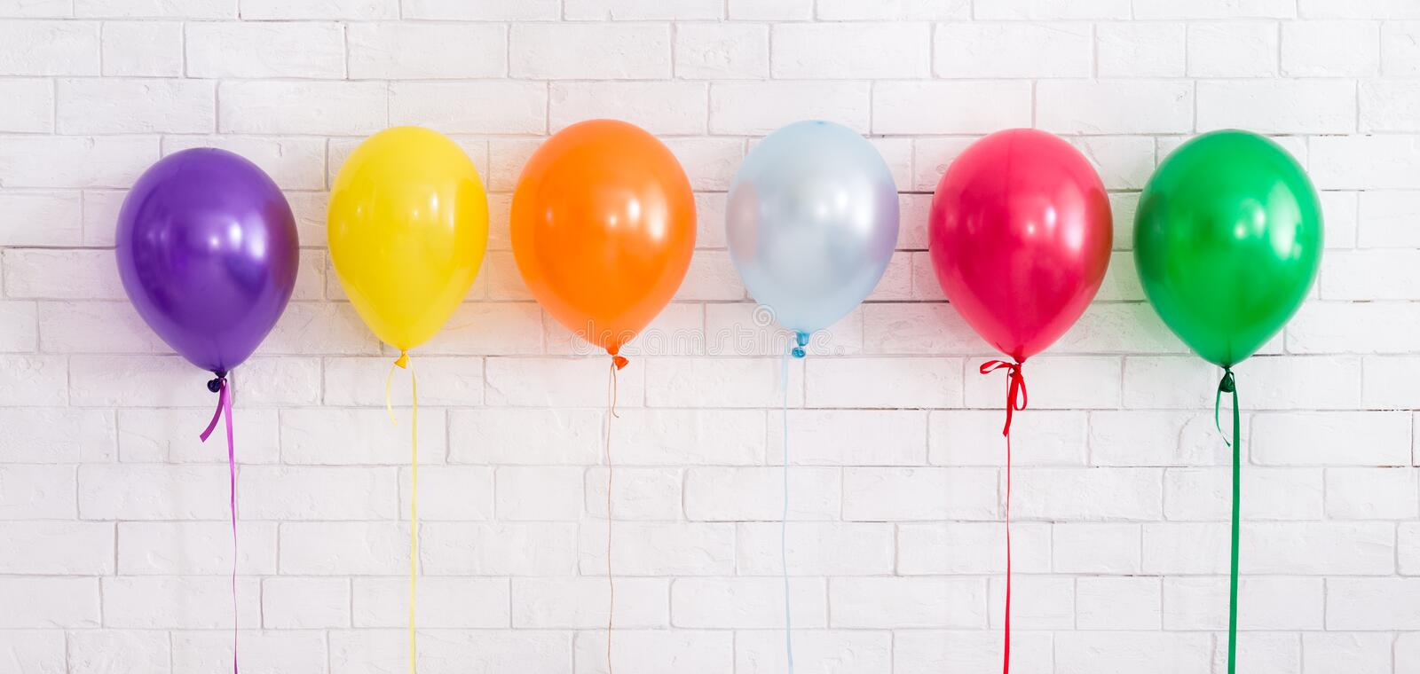 Set of colorful helium balloons for party celebration on white stock images