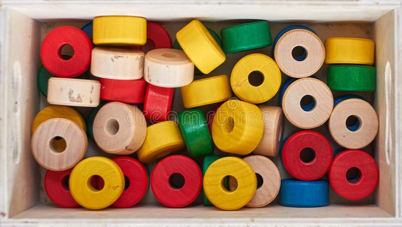 Set of colorful wooden cylinders stock photos