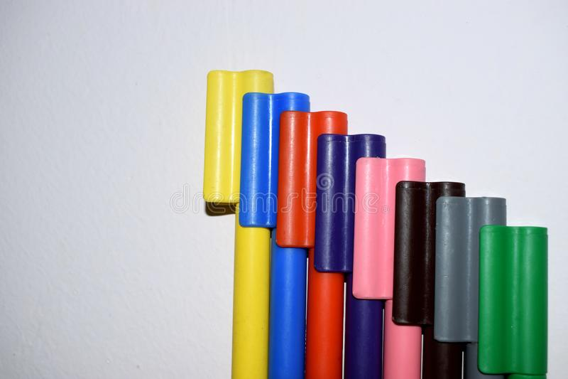 Set of Coloured marker pens attached together royalty free stock image