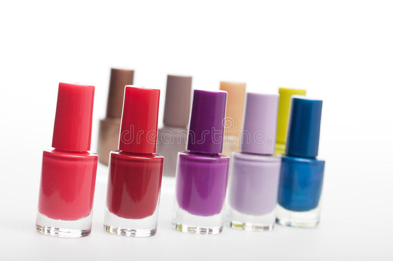 Set of colourful bottles of nail lacquer stock images