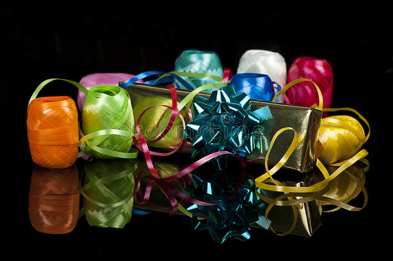 Set of colourful ribbons and a christmas  gift