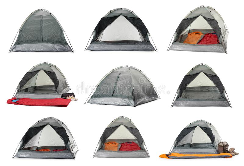 Set of comfortable tents and camping equipment. On white background stock photography