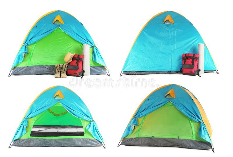 Set of comfortable tents and different camping equipment. On white background royalty free stock photo
