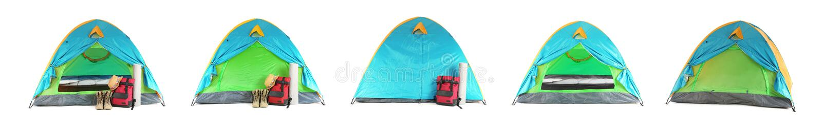 Set of comfortable tents and different camping equipment on white. Banner design. Set of comfortable tents and different camping equipment on white background royalty free stock image