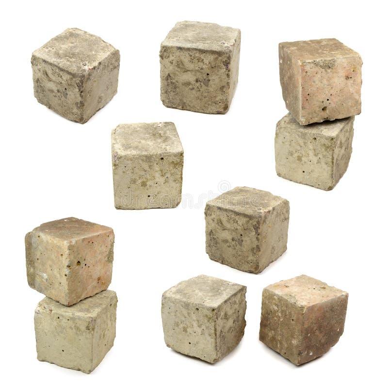 Set of concrete cubes on white background. royalty free stock image