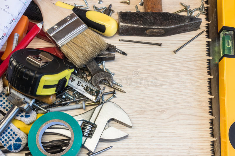 Set of construction tools, the tools lie around, center free, composition power tools. royalty free stock photos