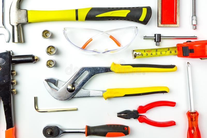 Set of construction tools on white background as wrench, hammer, pliers, socket wrench, spanner, tape measure, electric. Drill,safety glasses, screwdriver stock photo