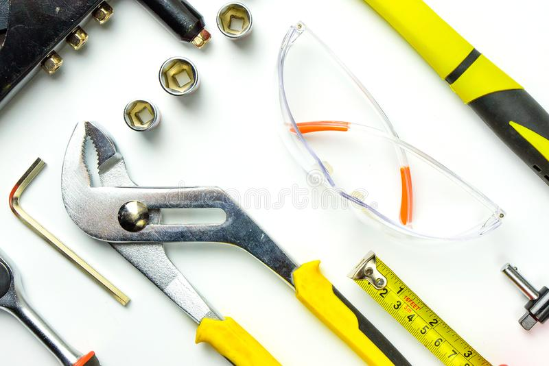 Set of construction tools on white background as wrench, hammer, pliers, socket wrench, spanner, tape measure, electric. Drill,safety glasses, screwdriver royalty free stock photo