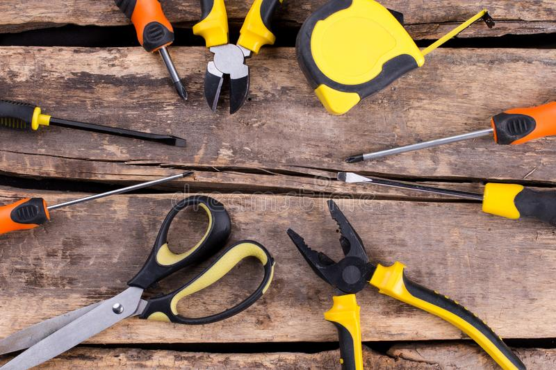 Set of construction tools on a wooden background. royalty free stock photos