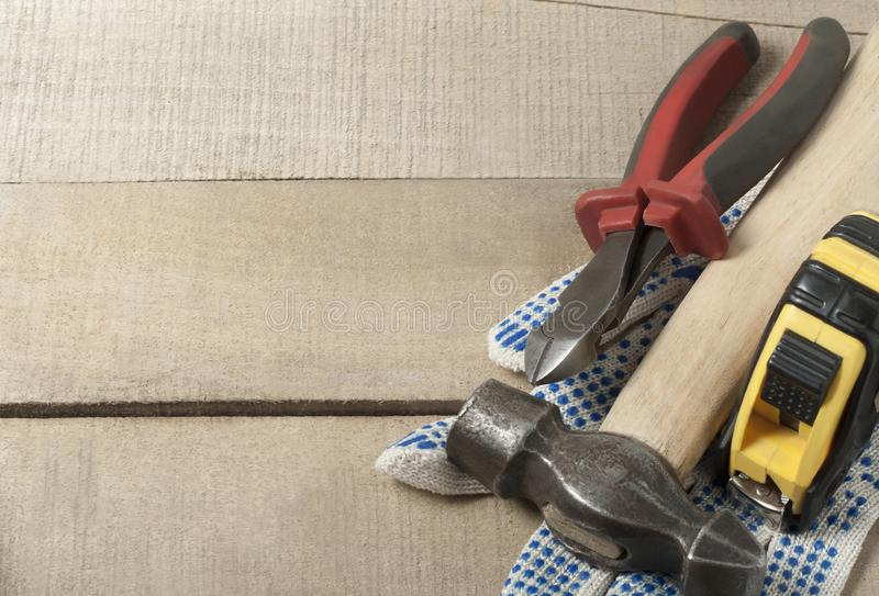 Construction tools and work gloves on wooden background .Copy space for text. stock photo