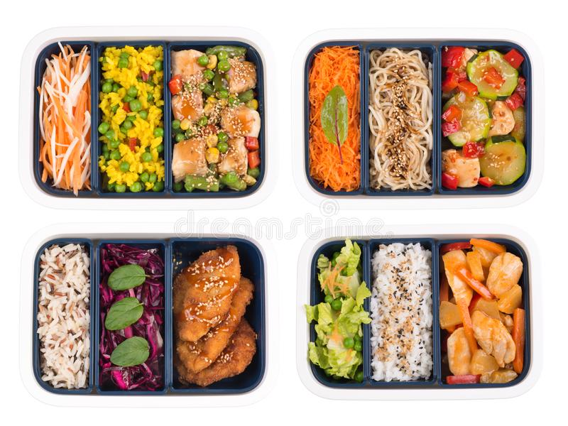 Set of cooked food in lunch boxes isolated on white background stock photography