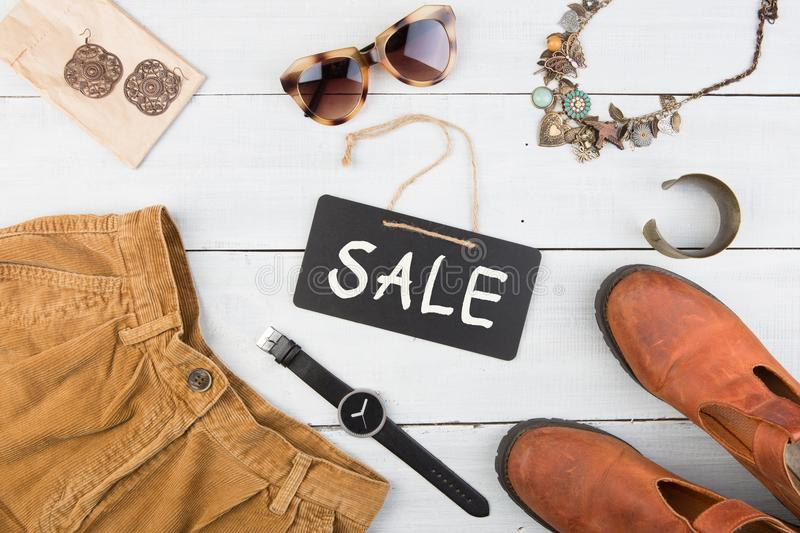 Sale concept - set of cool woman stuff and blank signboard. Set of cool woman stuff and sale signboard stock photos