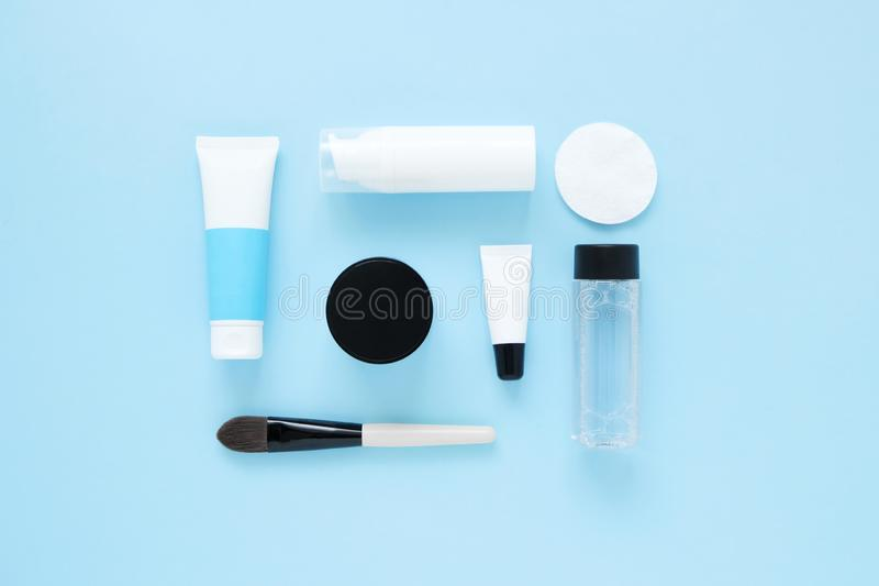 Set of cosmetic products on blue color background, flat lay with space for text. White tubes, branding mock up, top view. stock images