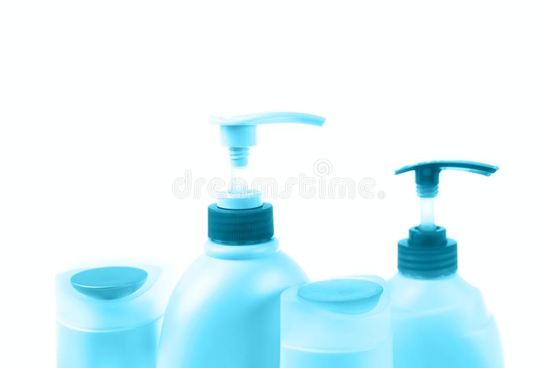 A set of cosmetics for the body tinted image blue. Hair care household chemicals perfumes packaging shampoo cream shower gel bottle jar dispenser items row royalty free stock image