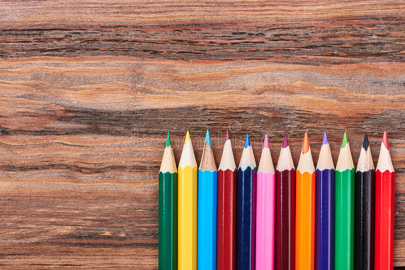Set of crayons on wood. royalty free stock image