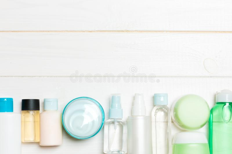 Set of cream and cosmetics bottles and jars on wooden background. Bodycare concept with empty space for your design.  stock images
