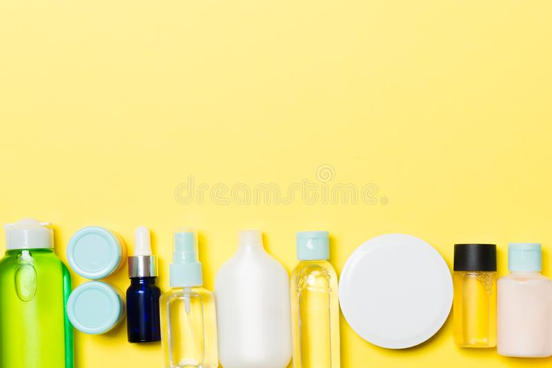 Set of cream and cosmetics bottles and jars on yellow background. Bodycare concept with empty space for your design.  stock photos