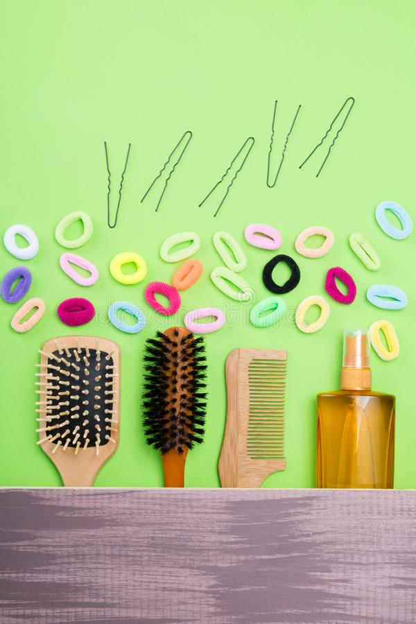 set for creating hairstyles and fixing them on a wooden background stock images