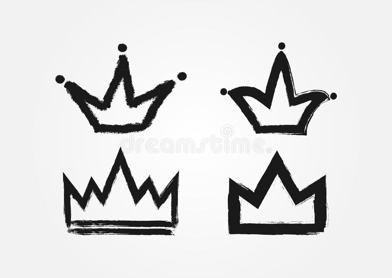 Set of crowns drawn by hand with a rough brush. Grunge. Set of crowns drawn by hand with a rough brush. Grunge, sketch, graffiti. Isolated black icons, logos stock illustration