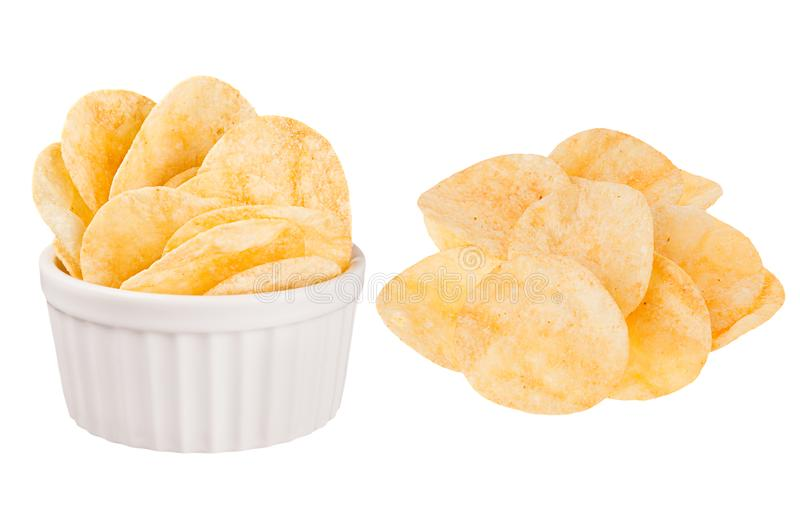 Set of crunchy golden potato chips as heap and in ceramics bowl isolated on white background. Fast food template for menu, advertising, cover stock photo