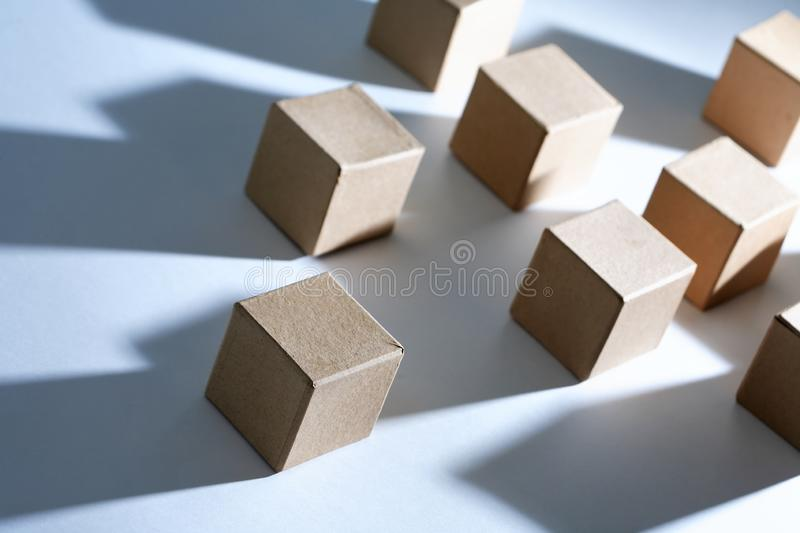 Set Of Cubes. Set of cardboard cubes on white background with light and shadows stock image