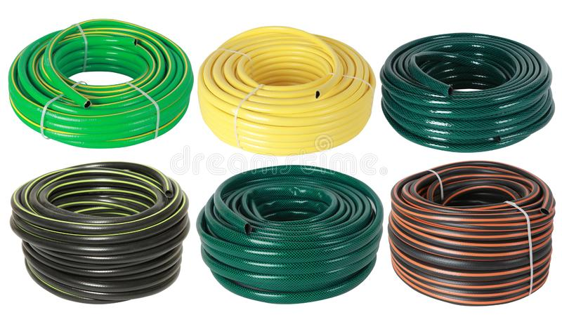 Set of curled plastic  garden water hoses pipes isolated royalty free stock photos