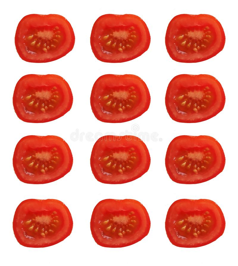 A set of cut red tomatoes in rows on a blank background stock photo