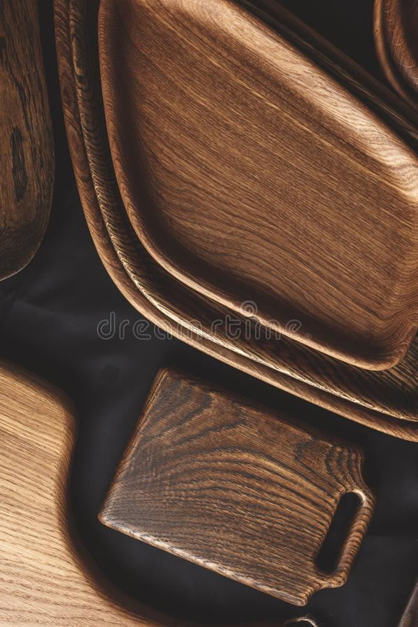 Set of cutting boards on wooden background royalty free stock photos