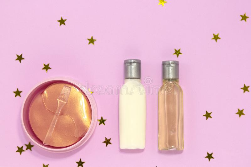 Set of decorative beauty accessories for woman - hydrogel cosmetic eye patch, jars and bottles with cream and gel for skin care on stock images