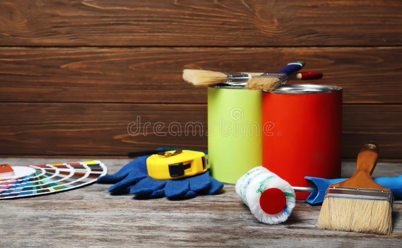 Set of decorator`s tools. On wooden table royalty free stock photo