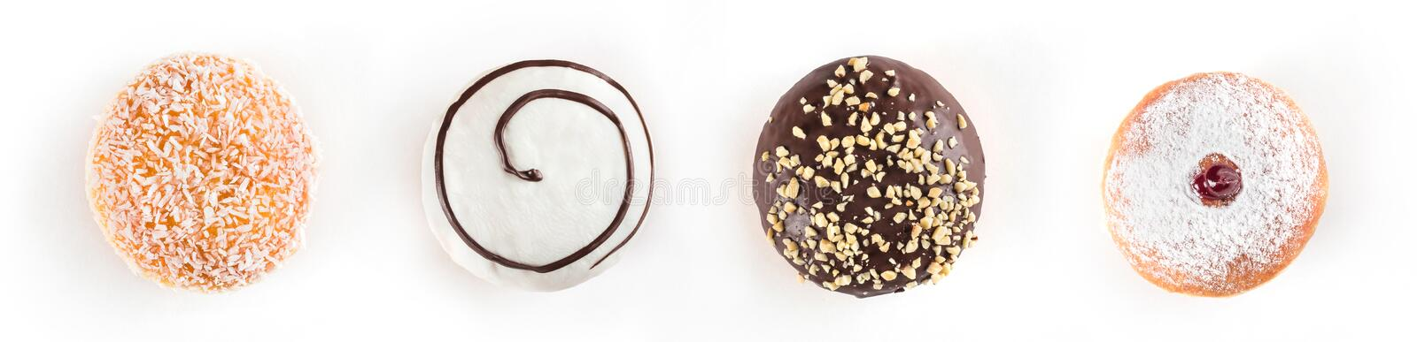 Set of delicious and assorted doughnuts isolated on white background, view from side stock photo