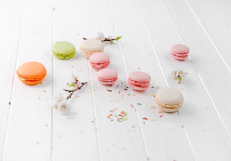 Set of delicious macaroons, pink, orange, pastel royalty free stock images